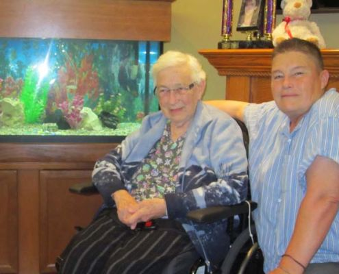 Michele Bouchier and her mother Marilyn are seen here in front of Frost Manor's new aquarium.