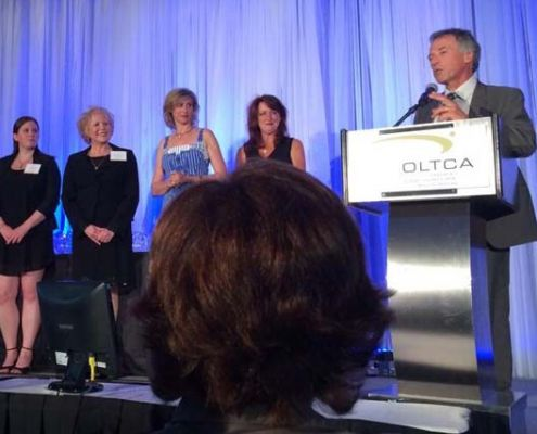 OMNI Health Care president and CEO Patrick McCarthy accepts the OLTCA's Innovation of the Year award.