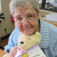 Pleasant Meadow Manor resident Nancy Lee poses with the teddy bear she made during a recent program.