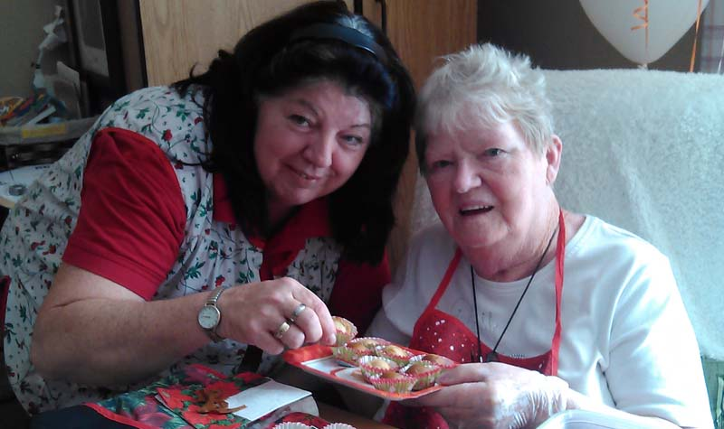 Country Terrace life enrichment aide Carol Cherry and resident Evelyn Vandenberg are seen here preparing cake pops.