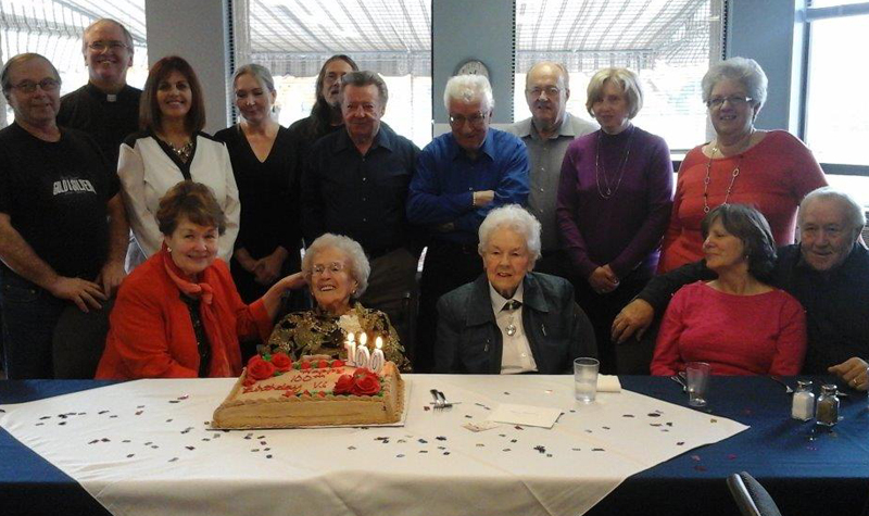 Almonte Country Haven resident Vi Larose sits in front of her birthday cake surrounded by loved ones who came to celebrate her 100th birthday.
