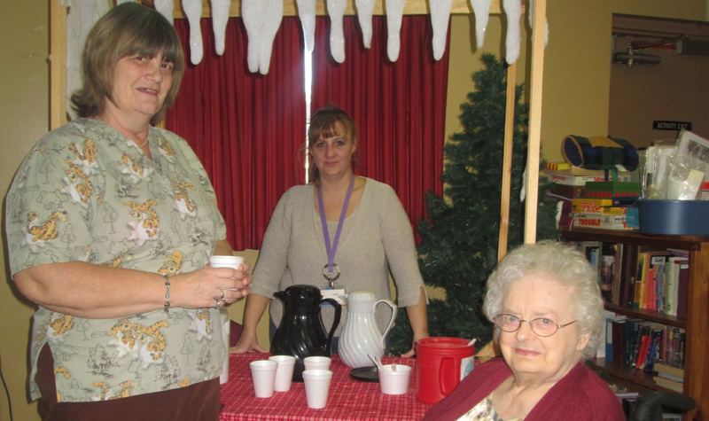 From left to right, Village Green personal support worker Deb Wales, life enrichment aide Vicki Hartin and resident Mable Martin take a timeout to enjoy refreshments during Winterfest.