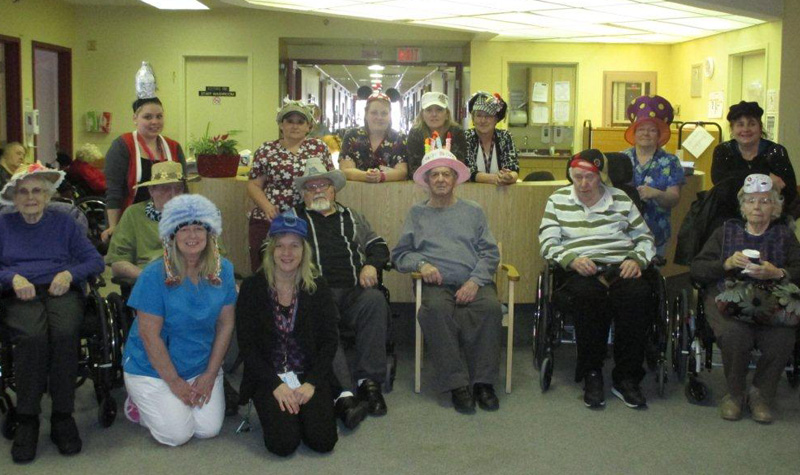 "Pleasant Meadow Manor residents and staff pose with their ""crazy hats"" on Feb. 24."
