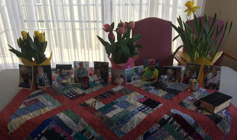 Streamway Villa hosted a ceremony March 24 to honour residents who have passed away this year. Pictured above is a table with residents' photos that was used as a centrepiece during the service.