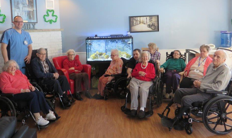 Almonte Country Haven residents are seen here along with the home's new aquarium.