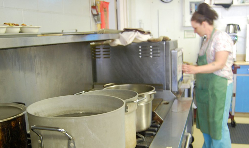 Maplewood fills pots and buckets of water to weather the shut-off of Brighton's water supply.