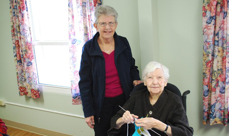 Willows Estate volunteer Jayne Philip (left) is seen here with resident Sybil Bellmore during a knitting program at the Aurora long-term care home.
