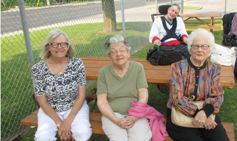 From left to right, Connie Murphy, Grace Hamblin and Eunice Best from Pleasant Meadow Manor are seen here at a tailgate party before a Peterborough Lakers lacrosse match July 6. Resident Chris Jones is seen at back.