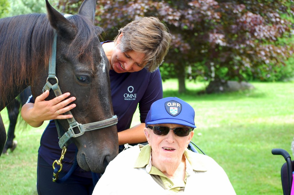 Maplewood administrator Rachel Corkery introduces her horse to resident John Closs.