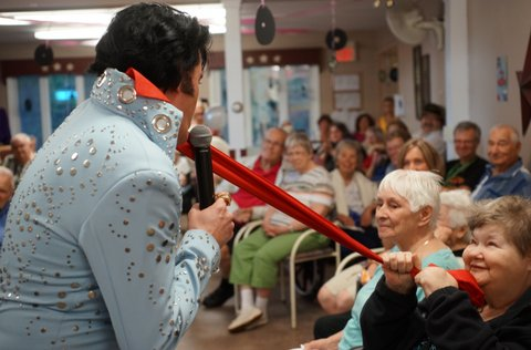 An Elvis Presley impersonator provides entertainment during West Lake Terrace's annual family barbecue.