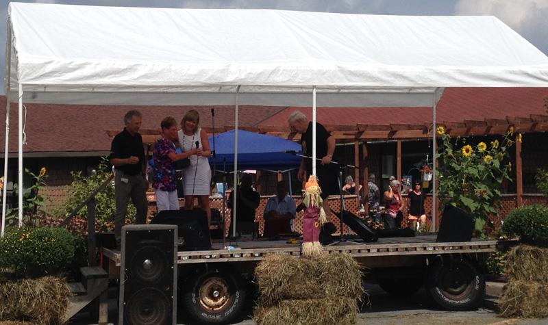 Debbie Kitchen receives the Elisabeth Hinton Memorial Award during the Woodland Villa Country Fair on Sept. 3.