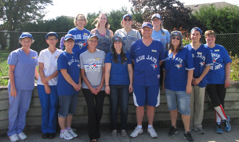 Wildwood Care Centre staff members are seen here wearing Toronto Blue Jays gear to show their support for the team, which finished first place in Major League Baseball's American League East. The long-term care home hosted a Blue Jays day as part of its 21st birthday celebrations.