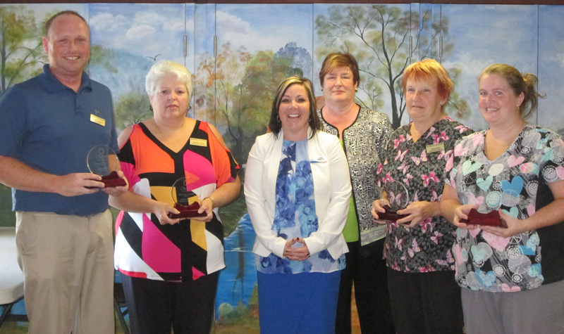Environmental services staff member Helene Near (second from right) received Wildwood Care Centre's Everyday Hero award this year. The home recently hosted a ceremony to honour her and administrator Scott Walsh (far left) who received the home's Inspired Leader award.