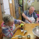 Pleasant Meadow Manor residents Grace Hamblin and Gerry Farrow are seen here preparing baked good for the Norwood Fall Fair.