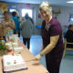 Linda Glover is seen here cutting the cake at her retirement party on Oct. 25. Glover retired after more than 30 years as a PSW at Maplewood.