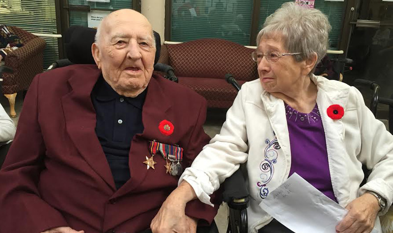 Jim and Mildred Bell participate in Rosebridge Manor's Remembrance Day ceremony.