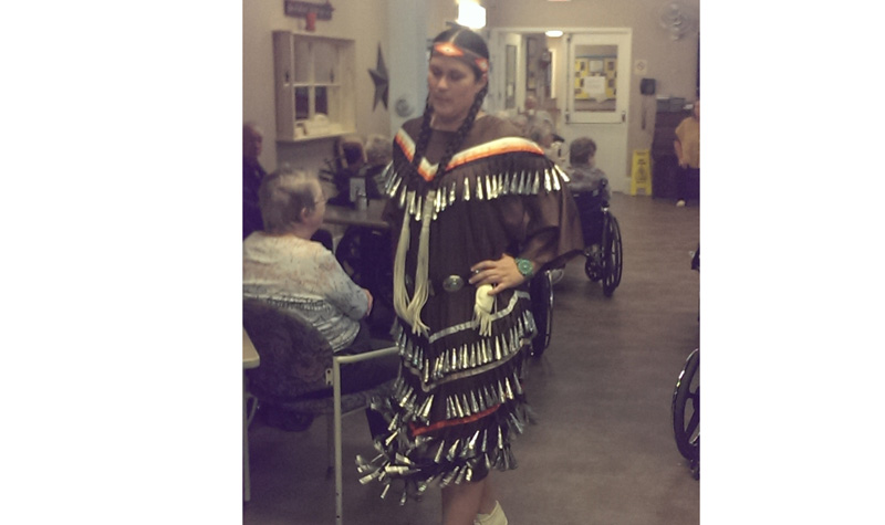 A member of Tyendinaga Mohawk Territory performs a dance of healing for West Lake Terrace residents.