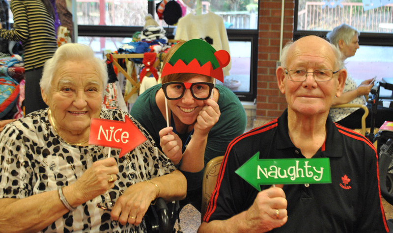 Country Terrace residents Aafke (left) and Folkert (right) Graansma flank life enrichment co-ordinator Christie Patterson in this photo taken during the home's Nov. 28 open house.