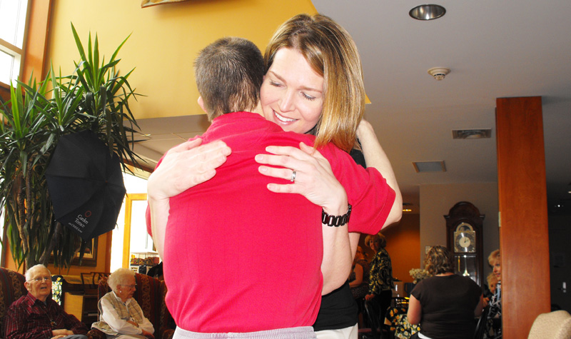 Garden Terrace administrator Carolyn Della Foresta hugging one of her buddies at the long-term care home.