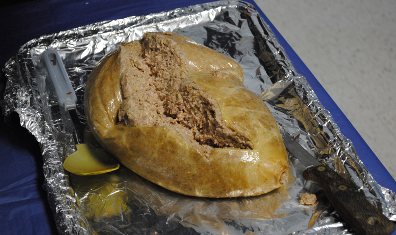 Pictured above is a haggis, the traditional Scottish meal consisting of minced organ meat, suet, onion, oatmeal and spices that's baked in a sheep's stomach.