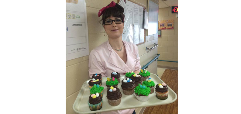 Streamway Villa nutritional care aide Sadie Mininni is seen here on Good Friday with a tray of cupcakes she made for residents and staff members.