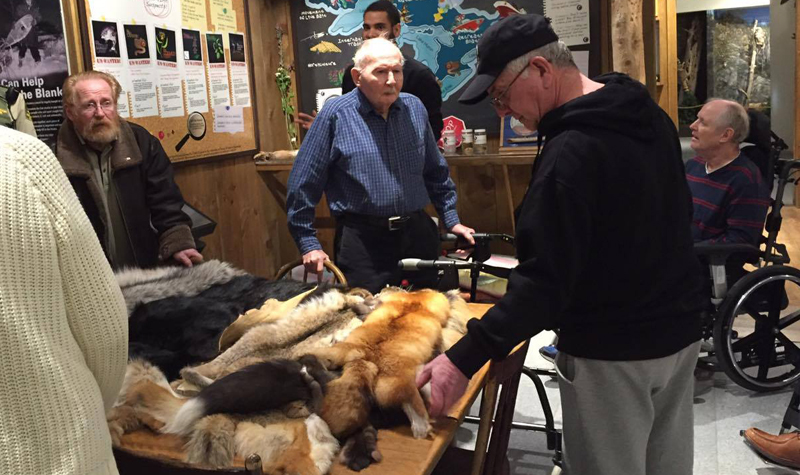 Streamway Villa residents are seen here looking at a pelt exhibit at the Mario Cortellucci Hunting and Fishing Heritage Centre in Peterborough.