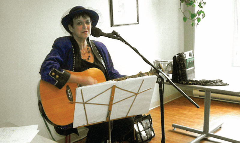 Entertainer Eileen Hennessy is seen here playing guitar for Frost Manor residents and their guests during the home's Mother's Day high tea on May 8.