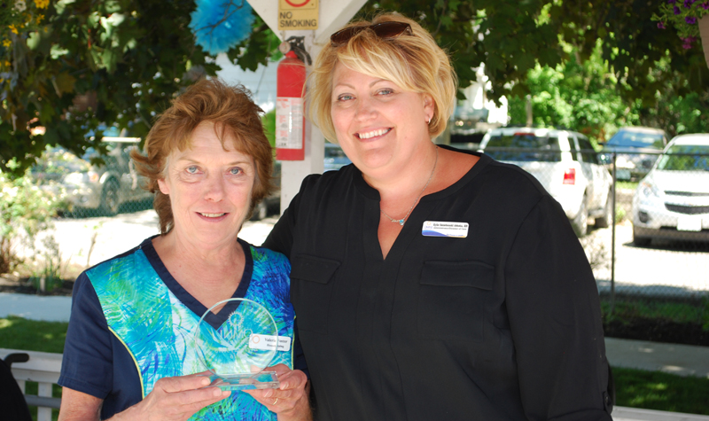 Streamway Villa environmental services staff member Valerie Foster (left) holds her Everyday Hero Award alongside Kylie Szczebonski, the home's administrator and DOC. Foster was presented with the award at a June 9 ceremony at the Cobourg long-term care home.