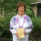 Pictured above, Country Terrace resident Gloria Marks holds a copy of her poetry book.