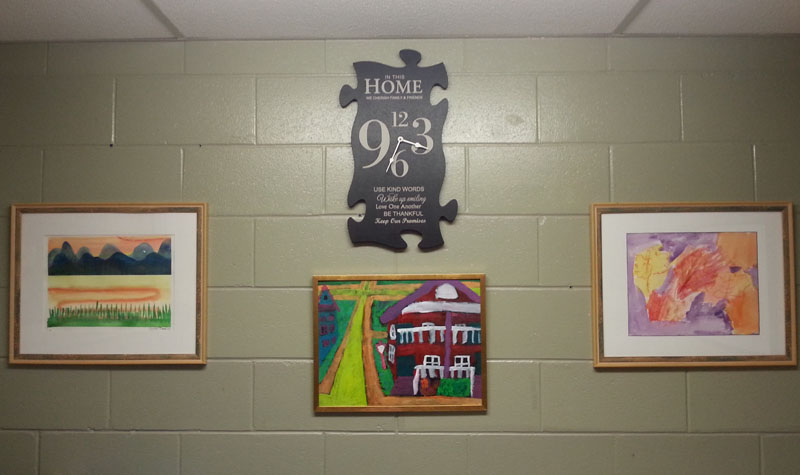 Pictured above are three pieces of artwork on display at Almonte Country Haven. About 10 paintings created by people accessing services from Lanark County Support Services' Life Skills program are being showcased at the home.