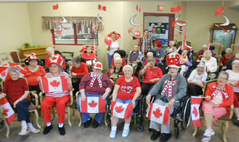 Decked out in red and white, Burnbrae Gardens residents are seen here cheering on Canada while watching the Olympics on TV.