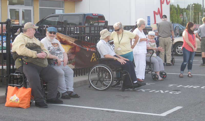 Village Green residents (pictured above) recently went to a car show at the A&W in Napanee.