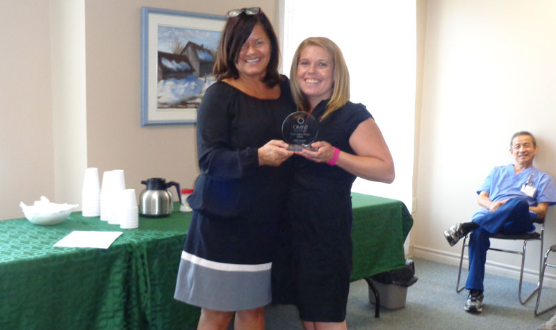 Forest Hill PSW (right) is seen here receiving her Everyday Hero Award from administrator Susan Bell.