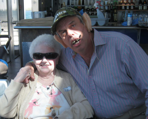Village Green resident Grace Huffman poses with entertainer Billy Bridger on Aug. 23 during a cruise of the Thousand Islands.