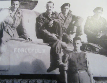 Marty Joiner, pictured top row, second from right, is pictured with his company along with their tank, Forceful III, during the Second World War.