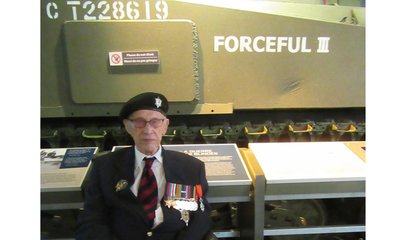 Marty Joiner is seen here with the tank he rode in during the Second World War, Forceful III, at the Canadian War Museum.