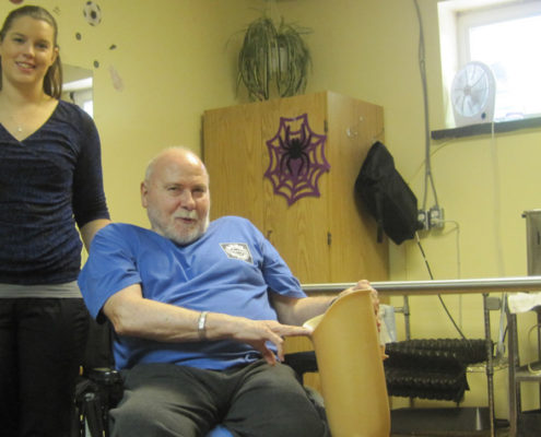 Riverview Manor resident Barry Hillmer poses with his prosthetic leg alongside physiotherapy assistant Jody Harris. Barry has been working at regaining his mobility and has made steady improvement since he started participating in the physiotherapy program earlier this year.