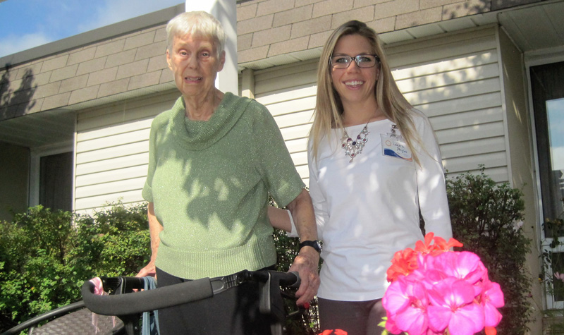 Springdale Country Manor resident Noreen Chandler (left) and physiotherapy assistant Laura Pammett are seen here in the Peterborough County long-term care home's garden.