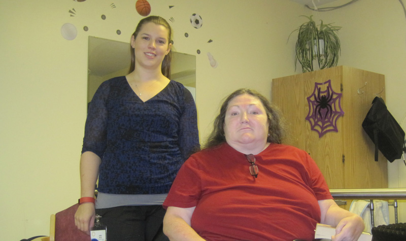 Riverview Manor resident Kellie MacDonald (right) is seen here with physiotherapy assistant Jody Harris. Kellie has improved her mobility through the Peterborough long-term care home's physiotherapy program. Her goal is to improve her strength to the point that she can once again live independently.