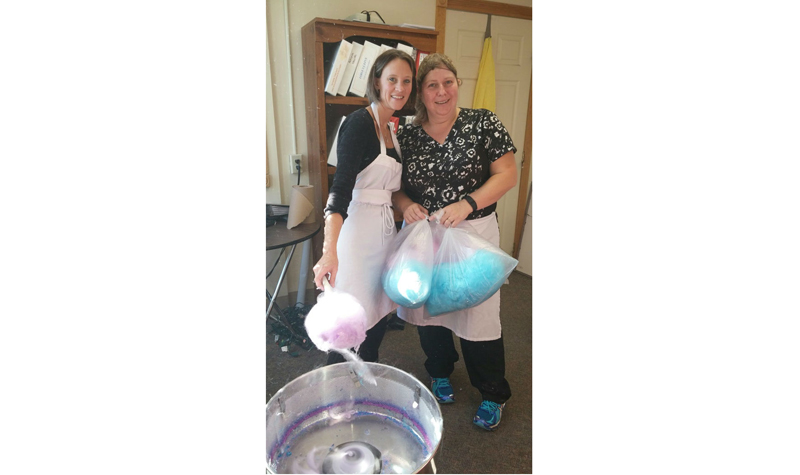Burnbrae Gardens administrator/life enrichment co-ordinator April Faux (left) and dietary aide Janet McInroy (right) are seen here during the Campbellford long-term care home's Nov. 9 cotton-candy fundraiser. The event raised $144 for the home's BSO program.