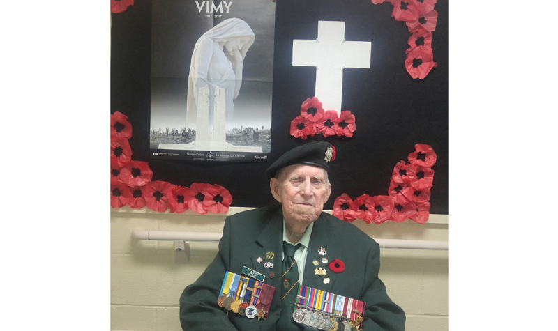 Burnbrae Gardens resident Phillip Ash is pictured here in his uniform in front of the memorial the home has created for Remembrance Day.