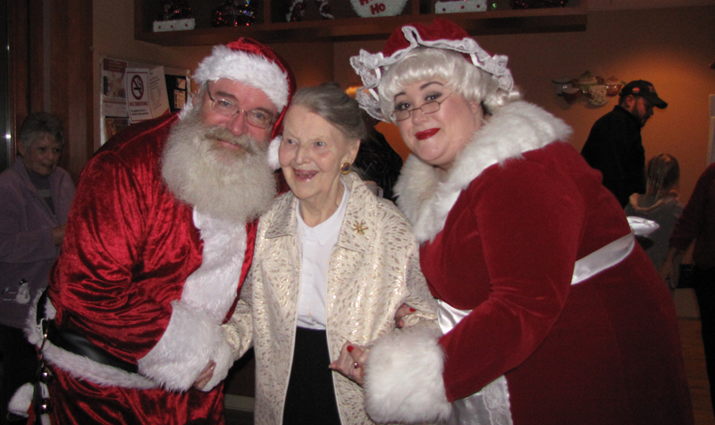 Garden Terrace resident Connie MacCallum is seen here with Santa and Mrs. Claus during the Ottawa-area long-term care home's annual Light Up the Courtyard event.