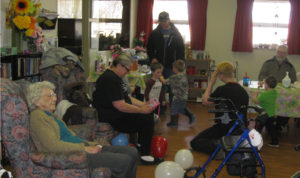 Children and grandchildren of Village Green residents and staff members gathered at the home March 26 for an Easter egg hunt. Aside from searching for chocolate Easter eggs, the children took time to mingle with residents.