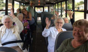 Pictured above, Frost Manor residents and staff are on a bus heading to Camp Cherokee on Rice Lake.