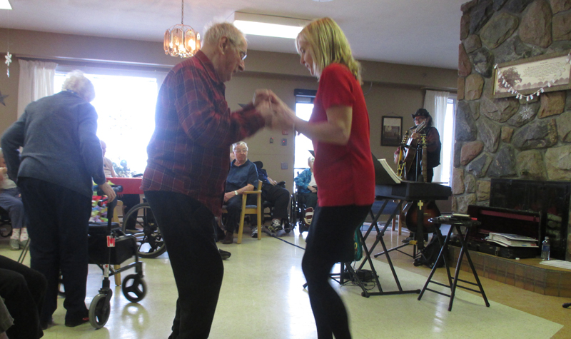 Resident Ken Austin and life enrichment co-ordinator Chris Garden share a dance during Pleasant Meadow Manor's Dec. 8 Christmas party.