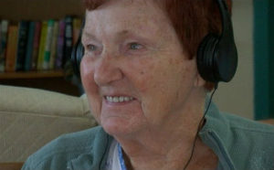 Streamway Villa resident Marion Carey listens to music on an iPod.